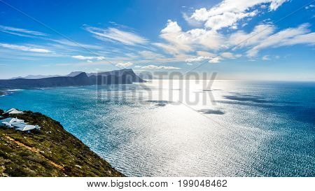 Sun reflecting of the waters of False Bay with Swartkopberg near Simons Town seen from Cape Point at the southern tip of the Cape Peninsula in South Africa