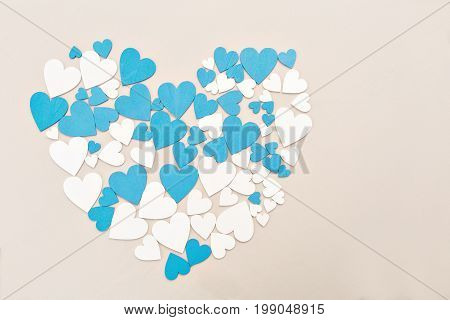Wooden hearts, blue and beige color. forming a heart, with a retro effect.