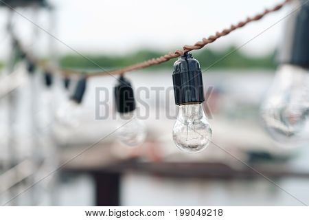 Incandescent bulbs Mountain Lake background. summer. wedding or holiday outdoors