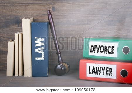 Divorce and Lawyer concept. Wooden gavel and books in background.