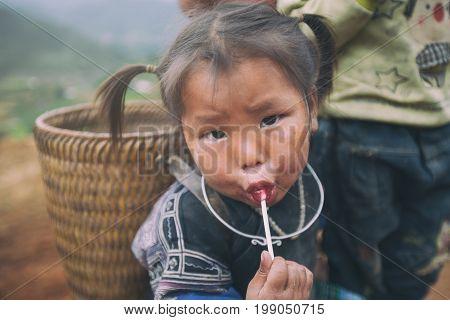 MUCANGCHAI, VIETNAM, MAY 24: H'mong ethnic minority children on May 24, 2017 in Mucangchai, Vietnam. H'mong is the 8th largest ethnic group in Vietnam.