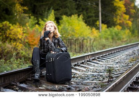 Nice Girl And Rails In Autumn