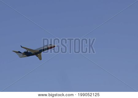 Passanger airplane flying in sky - air travel, telephoto