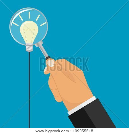 A hand with a magnifying glass looks at an lamp. Magnifying glass icon. Flat design vector illustration vector.