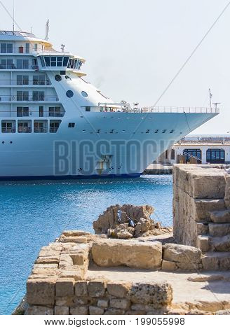 luxurious cruise ship docked on pier of Rhodes, Greece