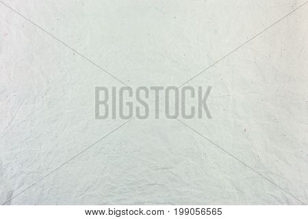 Crumpled Light Grey Paper Surface Texture With Multicolored Paper Fibers