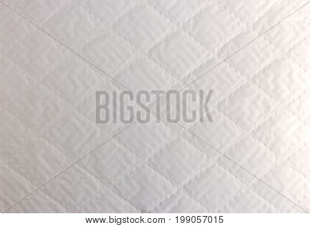 Abstract Background Texture Of White Bumpy Paper With Rhombs Shape