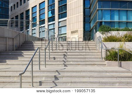 Staircase on modern building with metal railing
