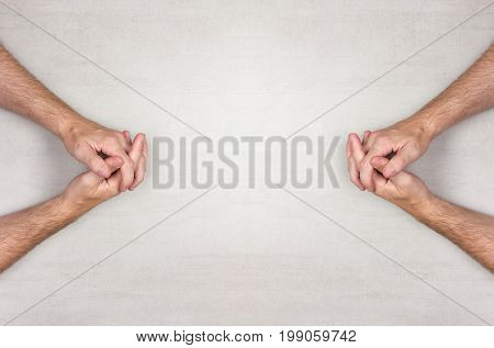 hands of a man are folded into a lock on a gray background top view. mock up for text phrases lettering