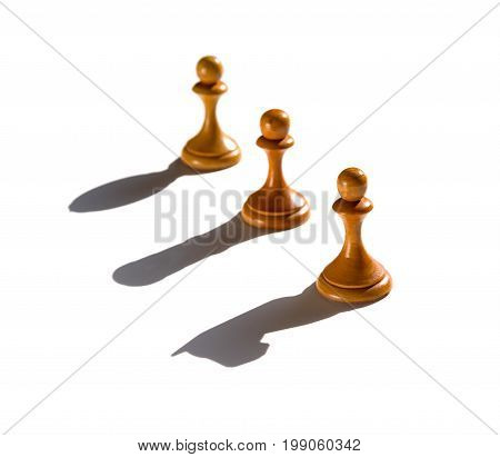 three chess pawn casting Knight Rook and Bishop shadow concept of strength and aspirations