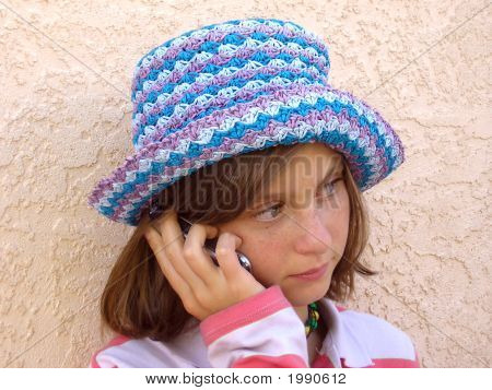 Pretty Teenage Girl In Blue Hat Talking On Cell Phone # 1