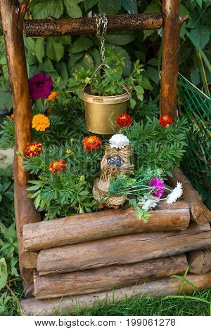 Toy With Flowers For A Well In The Yard
