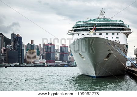 Cruise Liner On Background Of High-rise Buildings Hong Kong