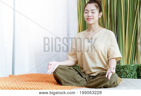 Young Thai girl is meditating before taking spa course