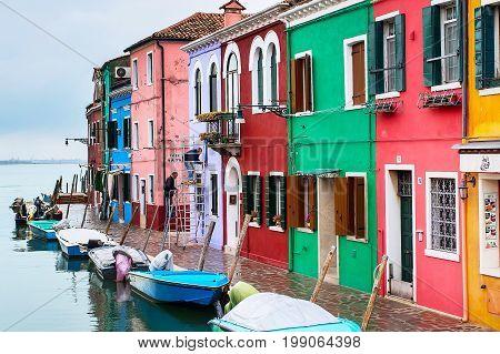 Burano Island, Venice, Italy - November 11, 2014: Venice landmark, Burano island with colorful houses and boats