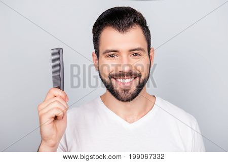 Confident Smiling Handsome Young Brunet Bearded Man In White T Shirt Is Standing On The Pure Backgro