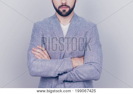 Close Up Cropped Portrait Of Young Handsome Brunet Bearded Businessman Lawyer In Grey Jacket. He Sta
