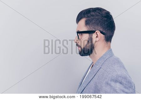 Side Profile Photo Of Successful Young Serious Handsome Brunet Bearded Businessman In Formal Outfit
