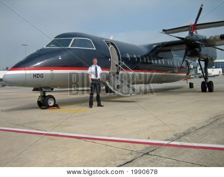 Young Captain In Front Of Jet