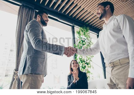 Low Angle Photo Of Three Business Partners In Formal Outfits Made A Deal About Their Business. Men A