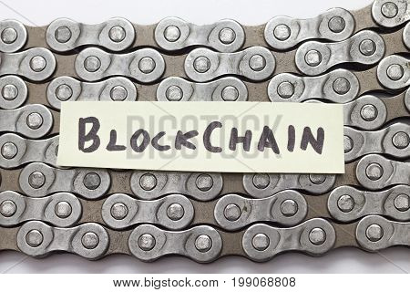 blockchain concept text on bicycle chain closeup