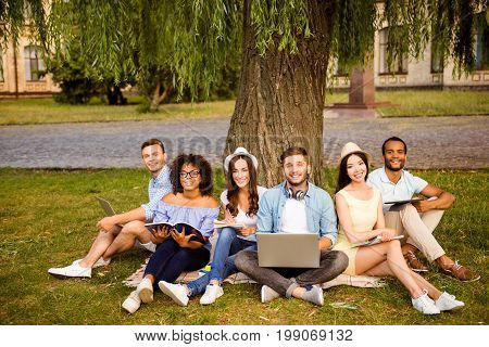Study Together Is Fun, Teamwork,teambuilding Concept. Six Happy Students Are Sitting Under The Tree