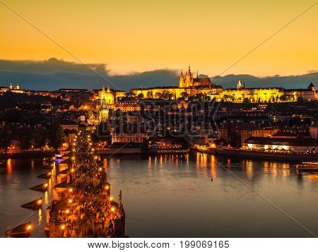 Prague evening panorama. Aerial view of Prague Castle and Charles Bridge over Vltava river from Old Town Bridge Tower, Czech Republic.