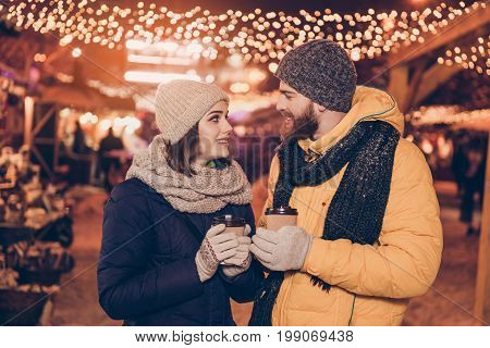 Close Up Side Profile Photo Of Beautiful Young Couple Outdoors At Winter On A New Year`s Eve With Ho