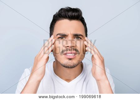 Close Up Photo Of Young Attractive Frustrated Man Looking For Acnes And Wrinkles On His Face, Sad Gr