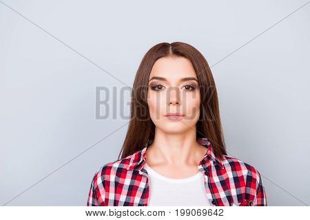 Close Up Portrait Of Serious Young Freelancer Brunette Lady, She Stands In Checkered Shirt On Pure L