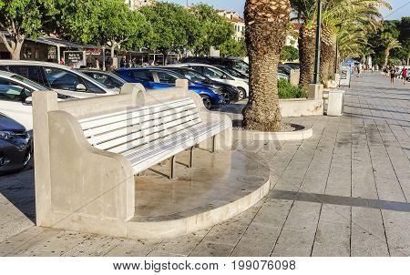 MAKARSKA, CROATIA - 5 JULY, 2017: Bench on the sea promenade in the city of Makarska.