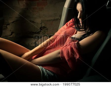 Sexy brunette driving a car, in lingerie