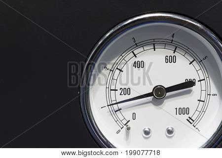 The industrial gauge (gage) on the black background.The industrial measurement instrument.