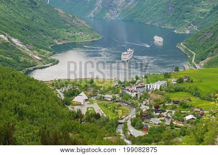 GEIRANGER, NORWAY - JUNE 02, 2010: View to the beautiful Geiranger fjord in Geiranger, Norway. Geiranger fjord is one of the most visited tourist sites in Norway. UNESCO World Heritage site.