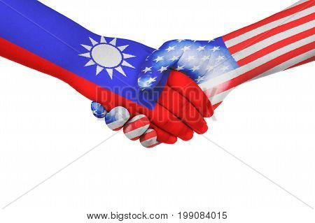 Handshake between United States of America and Taiwan with flags painted on child's hands in isolated white background