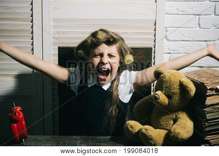 Child With Bear And Alarm Clock.