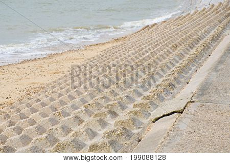 Concrete Coastal protection structure with beach and sea