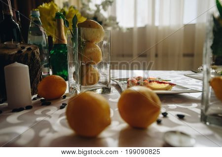 Delicate Lemon Wedding Composition With Food And Fruits.