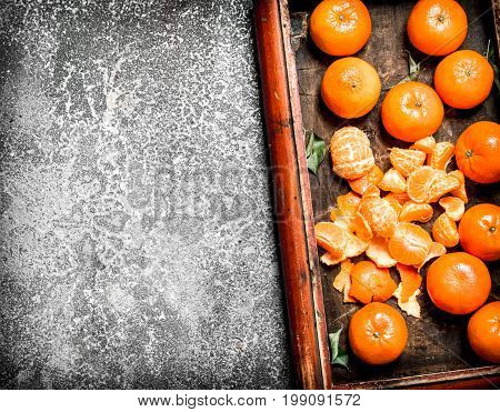 Ripe Peeled Tangerines With Green Leaves.