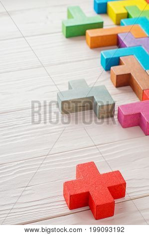 Concept of creative logical thinking. Different colorful wooden blocks on wooden background. Geometric shapes in different colors. Abstract Background.