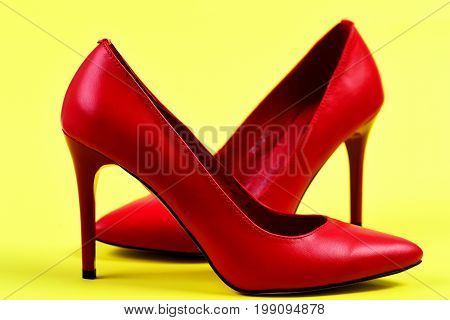 Formal High Heel Shoes On Yellow Background