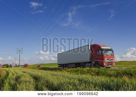 Truck on the road on a clear summer day. International cargo shipping.