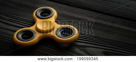 Close Up Yellow Spinner On A Black Background