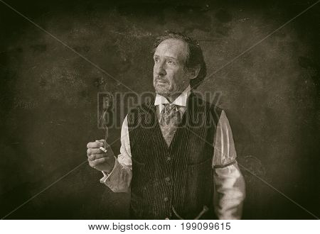 Classic Wet Plate Photo Of Man With Beard And Cigarette In Vintage 1900 Western Clothing.