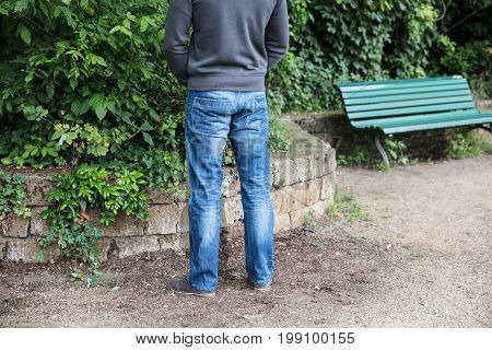 Rear View Of A Man Peeing In Park