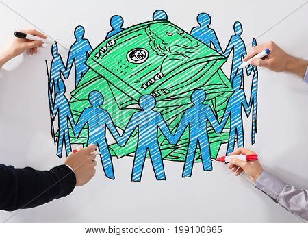 Close-up Of Business People's Hand Drawing Crowd Funding Chart With Marker On Whiteboard