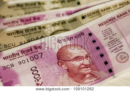 Closeup view of Mahatma Gandhi face on the Indian currency notes of Rupees 2000 nomination. Father of India Nation on official paper rupee currency.