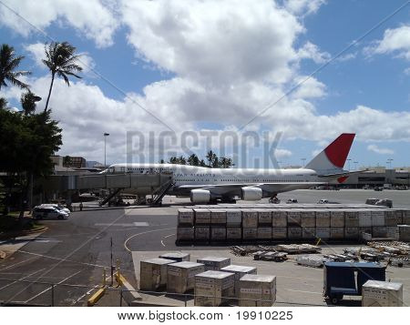 Large Jal Planes Sit At Honolulu International Airport Waiting To Load Up With Passengers For Their