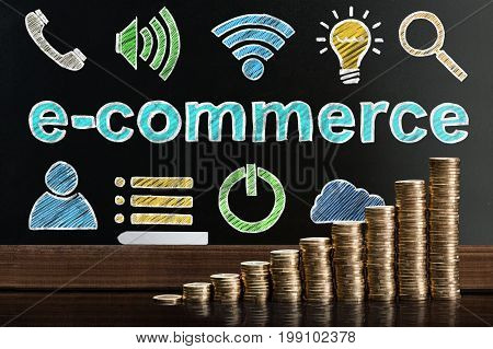 Ecommerce Online Shopping Concept On Blackboard Behind Coin Stacks