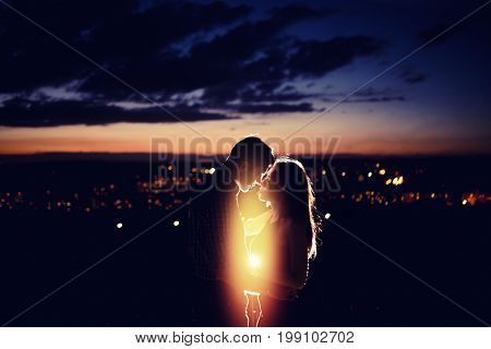 Texture with background for love: silhouette of loving couple against background of night city lights. Concept first love, feelings without boundaries, touch and flight of soul and consciousness